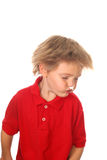 Sharp focus on shirt, child shaking his head Stock Images