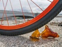 Sharp glass piece under bike tire Stock Photo