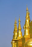 Sharp gold pagoda with sky Royalty Free Stock Photography
