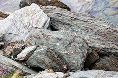 Sharp gray rocks on the beach Royalty Free Stock Photo