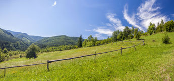 Sharp green mountain peaks and sky with dramatic clouds landscap Royalty Free Stock Photos
