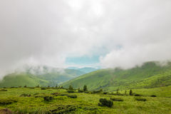 Sharp green mountain peaks and sky with dramatic clouds landscap Royalty Free Stock Photography