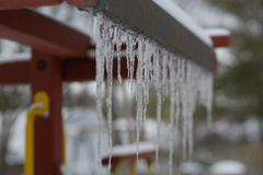 Sharp Icicles Hang from Children`s Fort stock photo