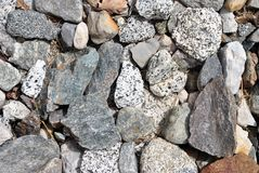 Sharp irregular. Stones of various types colorful and harmonious stock image