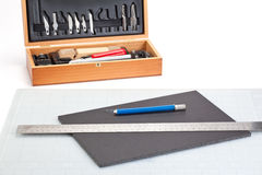 Sharp Knife and cutting tools. Over a piece of foam board Royalty Free Stock Image