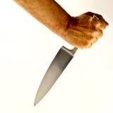 Sharp knife and hand. A man's hand holding a sharp steel hand Stock Photo