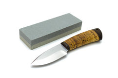 Sharp knife and a sharpening device Royalty Free Stock Photo