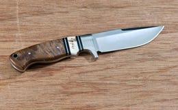 Sharp knife. On wood background Stock Photo