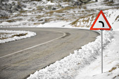 Sharp Left Curve. Sign on a mountain road stock photo