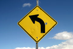 Sharp Left Turn Sign royalty free stock photo