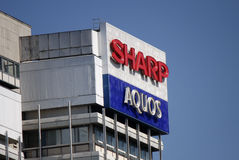 Sharp. May 2012 - BERLIN: the logo of the consumer electronic producers Sharp and Aquos, Berlin Stock Photography