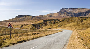 A Sharp Mountain Road Bend and Warning Sign. Taken in the Highlands of Scotland royalty free stock photo