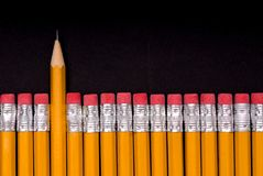 The Sharp One - on black. A sharp pencil amid a number of pencils eraser end up. Concept of a sharp or different individual or object amid many similar objects stock image