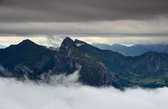 Sharp peaks, green valleys and layers of clouds in Carnic Alps Royalty Free Stock Images