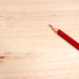 Sharp pencil placed on wood with copy spcae Royalty Free Stock Images
