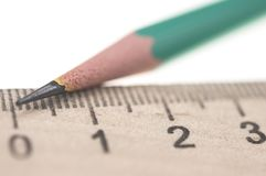 sharp pencil with the ruler isolated Royalty Free Stock Images