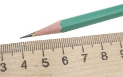 sharp pencil with the ruler isolated Royalty Free Stock Photo