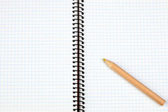 Sharp pencil on a spiral notebook Stock Image