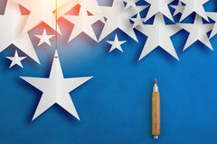 Sharp pencil and star paper cut on color background Royalty Free Stock Photography