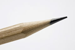 Sharp pencil tip. Macro view of sharped tip of wooden pencil, white studio background stock photo