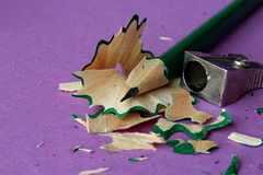 A sharp pencil. A sharp wooden pencil on painting artwork stock images