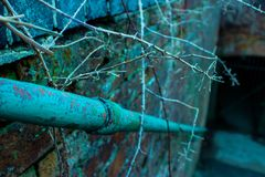 Sharp, Thorny railing to darkness. Sharp railing focusing on colour and detail of the thorns and discolouring of the rail and bricks to darkness royalty free stock photos