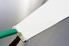Sharp razor. A sharp razor blade with a green handle Stock Photo
