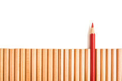 Sharp red color pencil stand out of other pencils Stock Photos