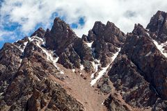 Sharp red mountain peaks. Tien Shan. Kirghizia Royalty Free Stock Photography