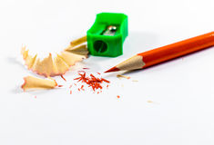 Sharp red pencil. And a green sharpener Stock Photos