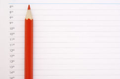 Sharp red pencil. On the schedule page Stock Photography