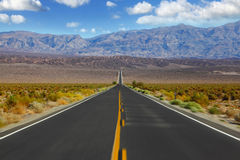 Sharp on the road. Crossing Death Valley in California. A trip to the high speed Stock Images