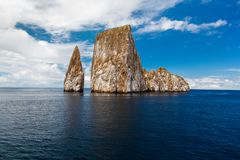 Sharp rock or islet called León Dormido Stock Photos