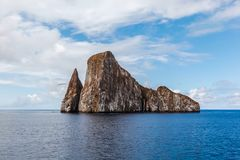 Sharp rock or islet called León Dormido Stock Image