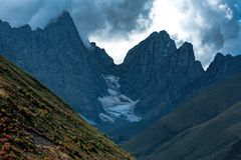 Sharp Roshkakhori mountain peaks in the clouds stock photography