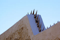 Sharp Rusty Spikes on Residential Boundary Wall Stock Images