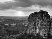 Sharp sandstone cliffs of Schrammsteine rocks above deep valley. Popular climbers resort. Royalty Free Stock Image