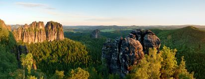Sharp Schramsteine and Falkenstein rocks in panoramic view. Rocks in the Elbe Sandstone Mountains park. Saxony, Germany Royalty Free Stock Images
