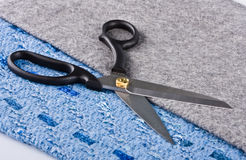 Sharp scissors against a fabric Stock Photography