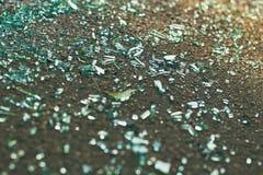 Shards of car glass on the asphalt. Sharp shards of car glass on the asphalt after car accident royalty free stock photography