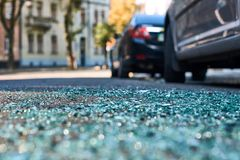 Shards of car glass on the street royalty free stock photos