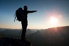 Free Sharp Silhouette Of A Tall Man On The Top Of The Mountain With Sun In The Frame. Tourist Guide In Mountains Royalty Free Stock Images - 63568939