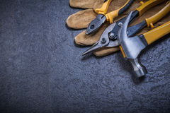Sharp steel cutter pliers leather safety glove Stock Image