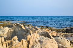 Sharp stones on the sea shore. natural background Royalty Free Stock Image