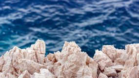 Sharp stones at the shores Royalty Free Stock Images