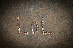 Sharp Stones texture alphabet day. Light stock image