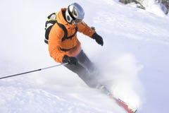 Sharp stop. Mountain ski rider in orange sharp stop Royalty Free Stock Photos
