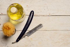 Sharp straight razor, brush and cologne aftershave Stock Photography
