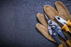 Sharp tin snips pliers leather safety glove Royalty Free Stock Image