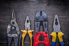 Sharp tin snips steel cutter pliers on wooden Stock Photography